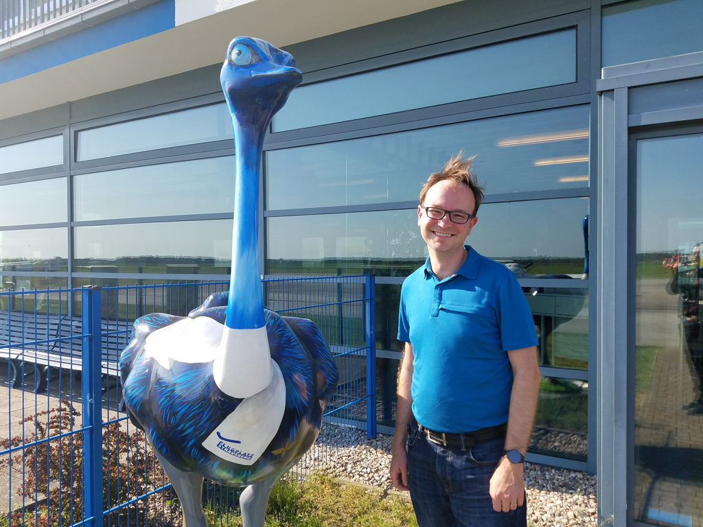 Author posing with the airport's ostrich